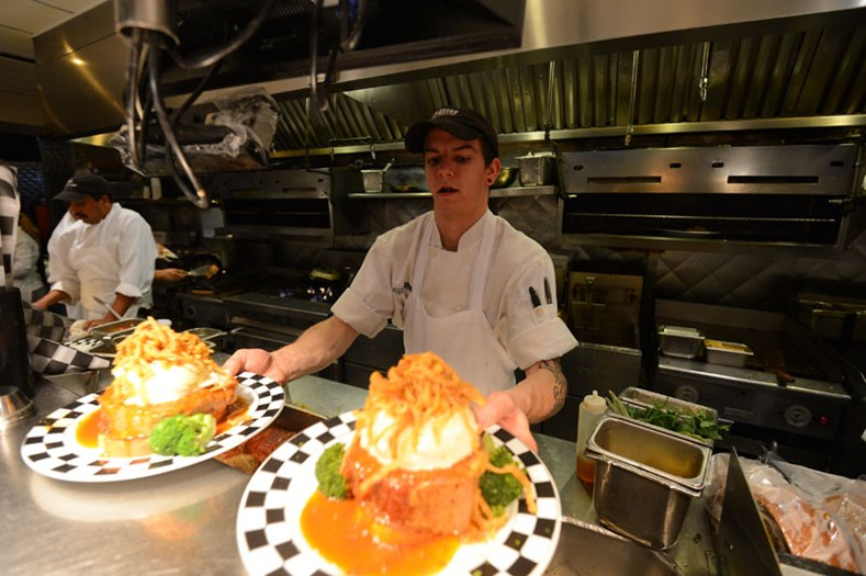 A chef preparing meatloaf dishes