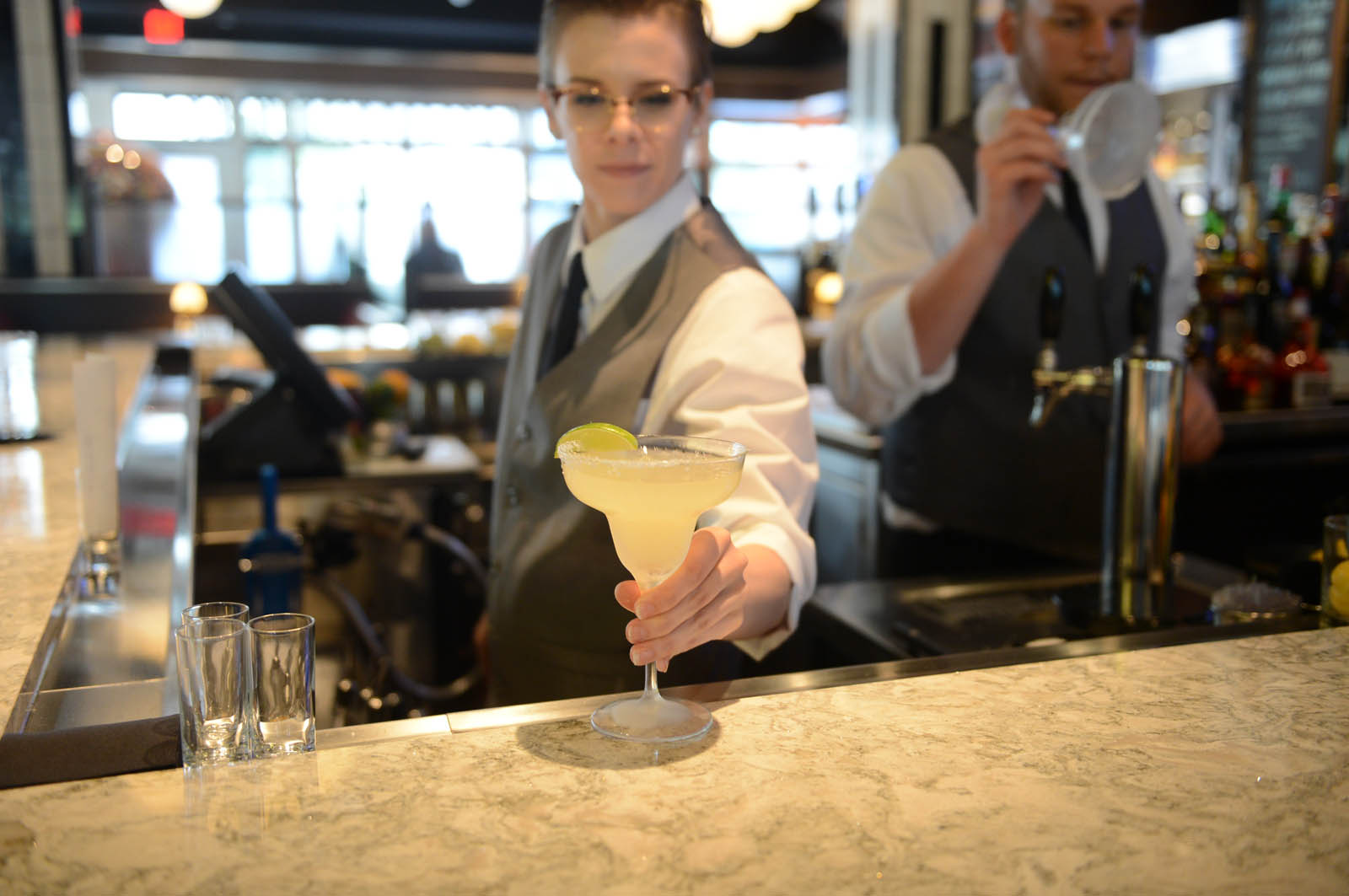 A bartender serving a delicious drink